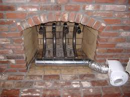 interior brick fireplace with metal fireplace blowers for