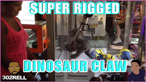 Arcade Meme - jurassic park dinosaur claw crane machine is it rigged arcade