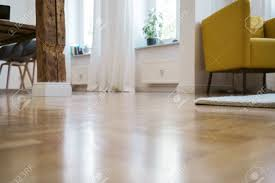 open plan flooring low angle view across a polished parquet floor of a deserted