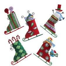 and green skate ornaments in whimsical design by raz imports