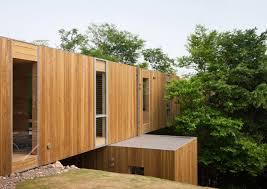 modern cantilevered home stacked like building blocks design milk