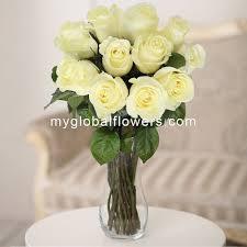 White Roses In A Vase Buy Flowers One Dozen White Roses Roses In World