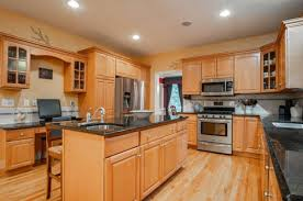 kitchen countertop ideas with maple cabinets backsplash paint ideas for maple cabinets and black