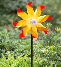 yellow flower wind spinner with solar globe garden made from