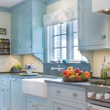 classic light blue kitchen decor and design for blue kitchen walls with brown cabinets white farmhouse near window between