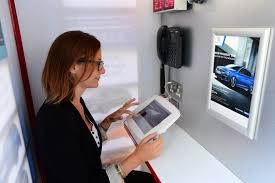 peugeot car showroom world u0027s smallest car dealership is a peugeot london phone box