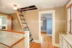 hallway interior with folding attic ladder stock photo 590162684