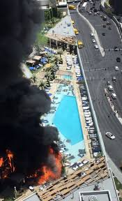 las vegas strip s cosmopolitan hotel engulfed in huge fire daily an aerial view of the blaze shows how the flames ripped through palm trees and cabanas