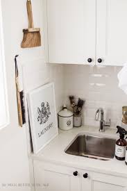 Sink In Laundry Room by Beautifully Organized Small Laundry Rooms The Happy Housie
