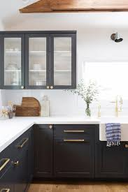 black shaker style kitchen cabinets black shaker cabinets with brushed gold pulls and knobs