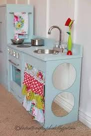 childrens play kitchen made out of an old entertainment center