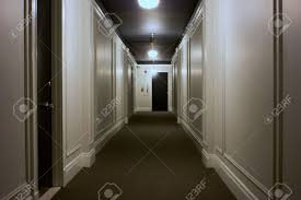 long interior hallway showing doors lights ceiling carpet stock