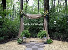 wedding arches decorated with burlap outdoor wedding arch or burlap with flowers and boston ferns