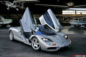 mclaren f1 factory mclaren f1 silver love the way the doors open my kinda cars
