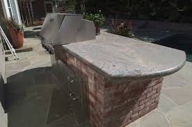 Backyard Brick Patio Design With Grill Station Seating Wall And by Brick Walls And A Granite Countertop To Compliment The Bluestone
