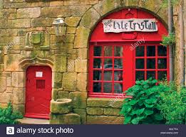 red door and window of medieval stone house locronan brittany