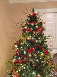christmas tree with pine cones and berries christmas lights