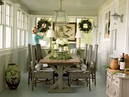 casual dining room chairs this porch turned dining room is effortlessly chic wicker chairs