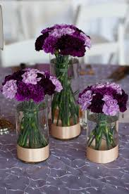 Shades Of Purple Trio Of Cylinder Vases With Varying Shades Of Purple Carnations