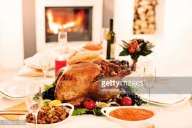 thanksgiving dinner table spread with light stock photo