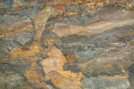 flat multi color foliated slate rock with abstract like landscape
