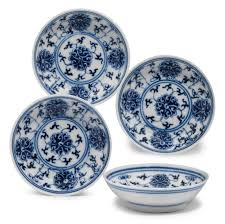a of four small blue and white lotus saucer dishes