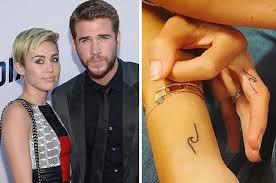 miley cyrus and chris hemsworth u0027s wife got matching tattoos