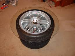 make a table out of those old wheels in your garage 7 steps