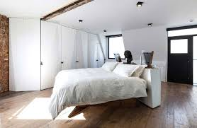 country white loft bedroom with mini platform bed beside big