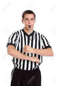 Teen basketball referee giving sign for traveling stock photo