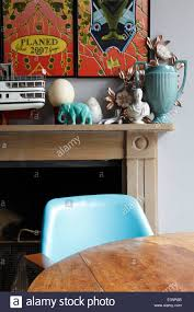 corner of dining table in front of fireplace with ornaments