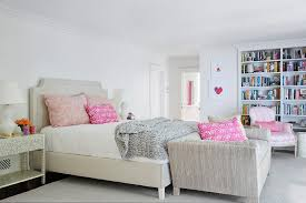 pink and gray grownup bedroom with sofa transitional bedroom