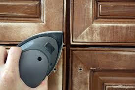 how to sand and paint cabinets a small sander to sand kitchen cabinets before painting