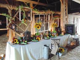 sunflowers and green apples in a rustic barn wedding setup and