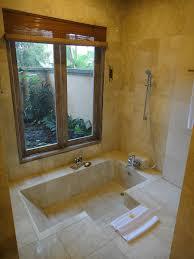 marble statuary sunken bathtub waka di ume resort ubud sunken