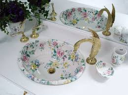 chintz fluted sink with swan faucets traditional bathroom