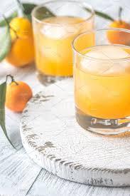 colors of orange two glasses of orange juice food u0026 drink photos creative market