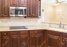 oak kitchen cabinets with stainless steel appliances stainless steel appliances granite countertops and wood