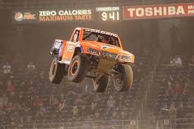 monster truck racing super series stadium super trucks are like mini trophy trucks and they are