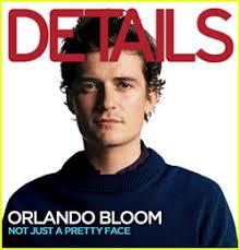 orlando bloom sits a tree studies his navel details