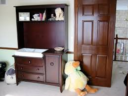 cherry changing table dresser combo storage baby changing table dresser combo dennis hobson design