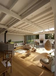 wood slat home with utterly open living spaces