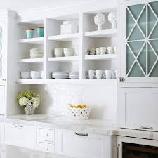 glass cabinets in white kitchen white kitchen with blue glass cabinet doors transitional