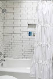 withkendra the shower is such a transformation before it looked much smaller extending the subway tile all the way to the ceiling really helps to make the bathroom