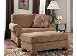 country style living room with oversized chairs plus ottoman set