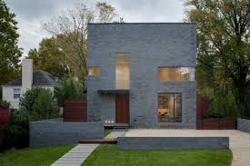small home design with brick and concrete eksterior wall design