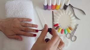 manicure process in salon cleaning gel nail polish to cover new