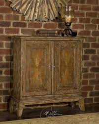uttermost maguire distressed console cabinet 25526