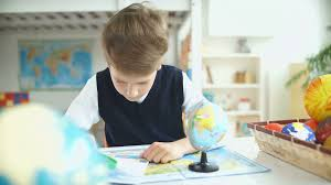 small desk globes young student studying for geography with a globe stock