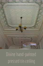 this is a beautiful pressed tin ceiling that has been hand painted